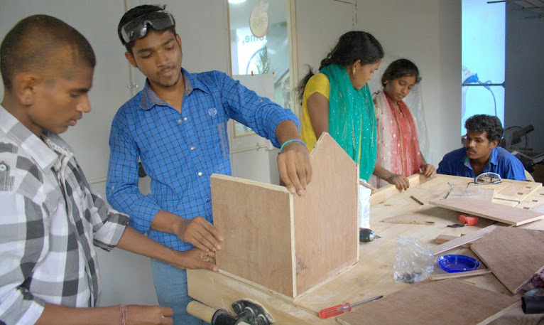 Photo of participants doing carpentry and design workshop.